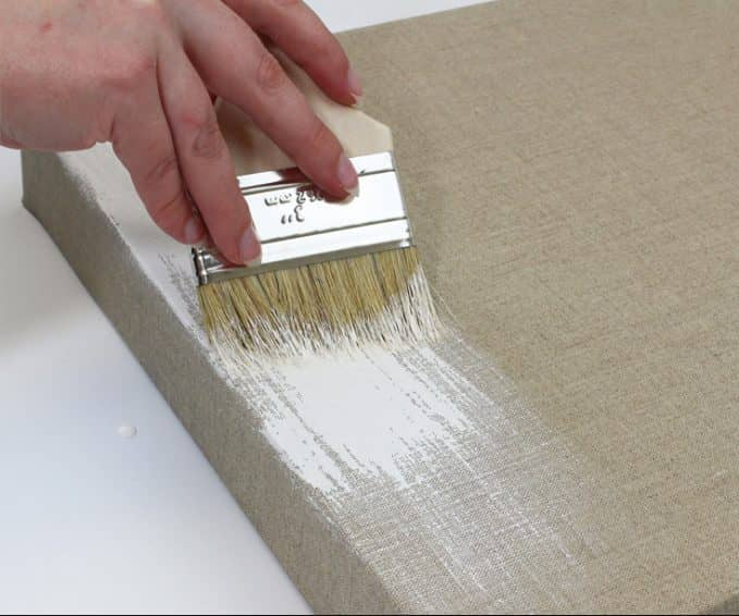 To apply gesso for acrylic paint project use a paint brush and use even strokes